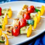 SQ picture with a close up on the vegetables in these greek kebabs