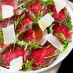 Close up on the peppered edges of the beef carpaccio