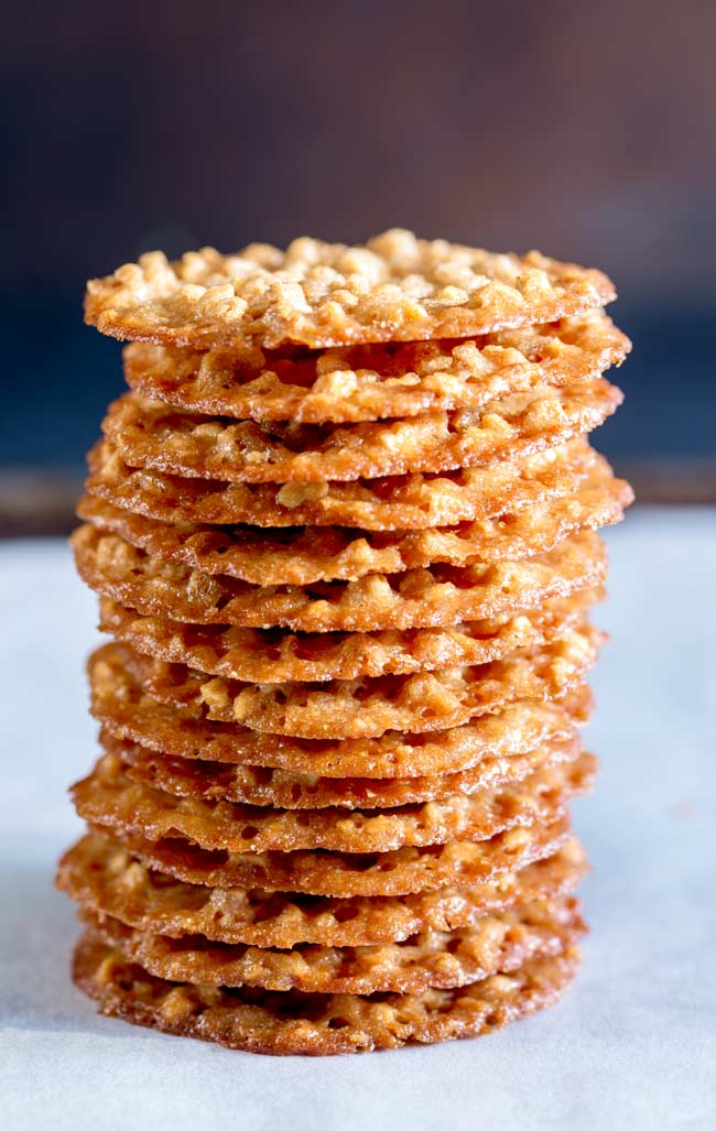 Stack of 16 peanut thins, on a baking tray .