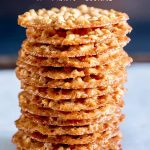 stack of cookies with a blue background and text at the top