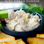 close up on a celery button stopping up the creamy smoked fish dip. Text at the top of the image