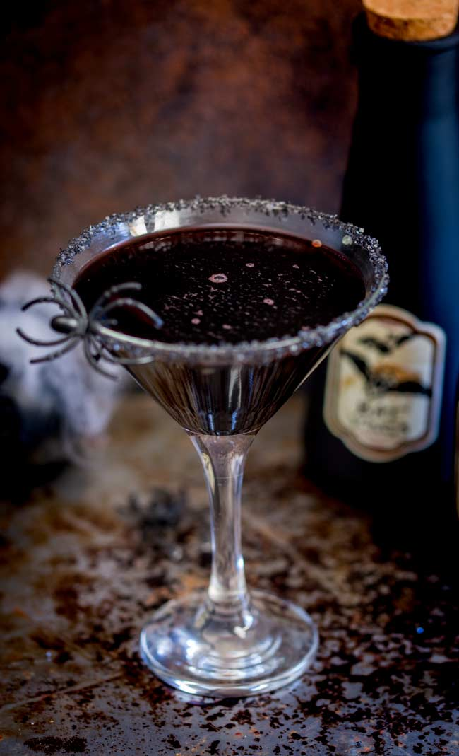 martini glass with the cocktail using black vodka, it is a much deeper darker burgundy color