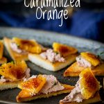 close up on the caramelized oranges on the toast and pate platter