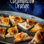 platter of toast and pate with caramelized oranges with text at the top