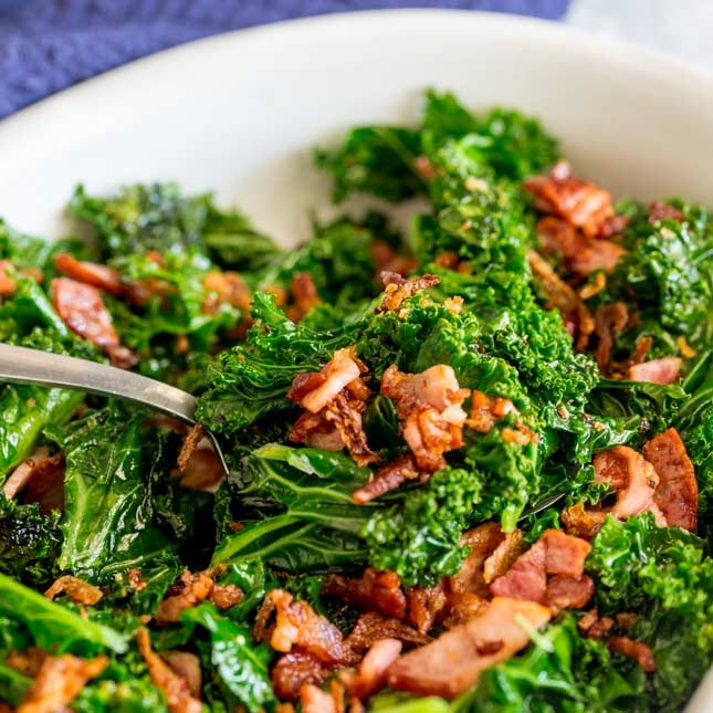 close up on a spoonful of sautéed kale
