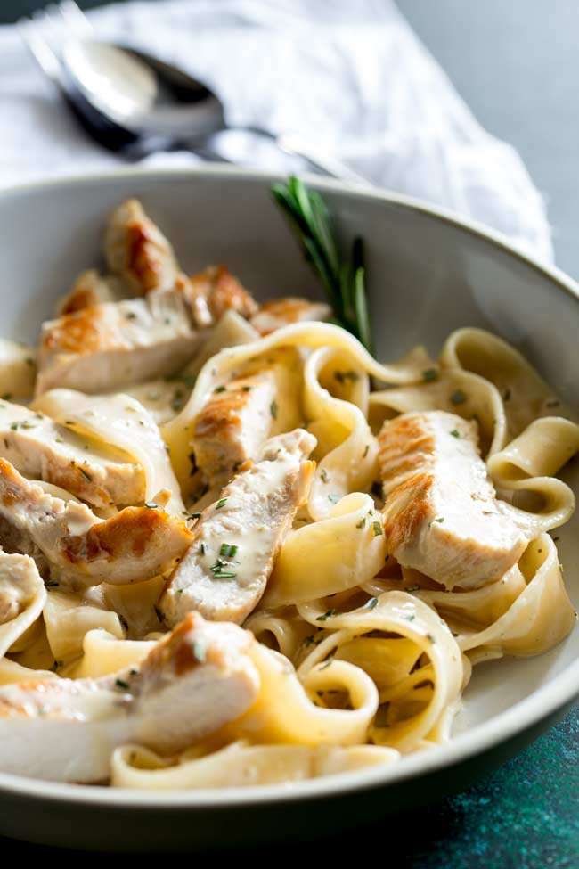 head on photo showing the thick pappardelle pasta coated in creamy rosemary sauce with chunks of chicken