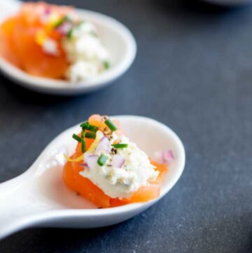 square photo showing a close up on the smoked salmon amuse spoon