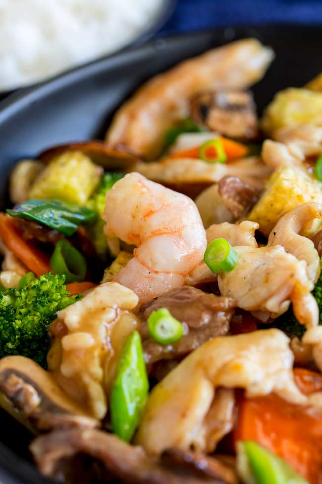close up on a shrimp in the happy family stir fry