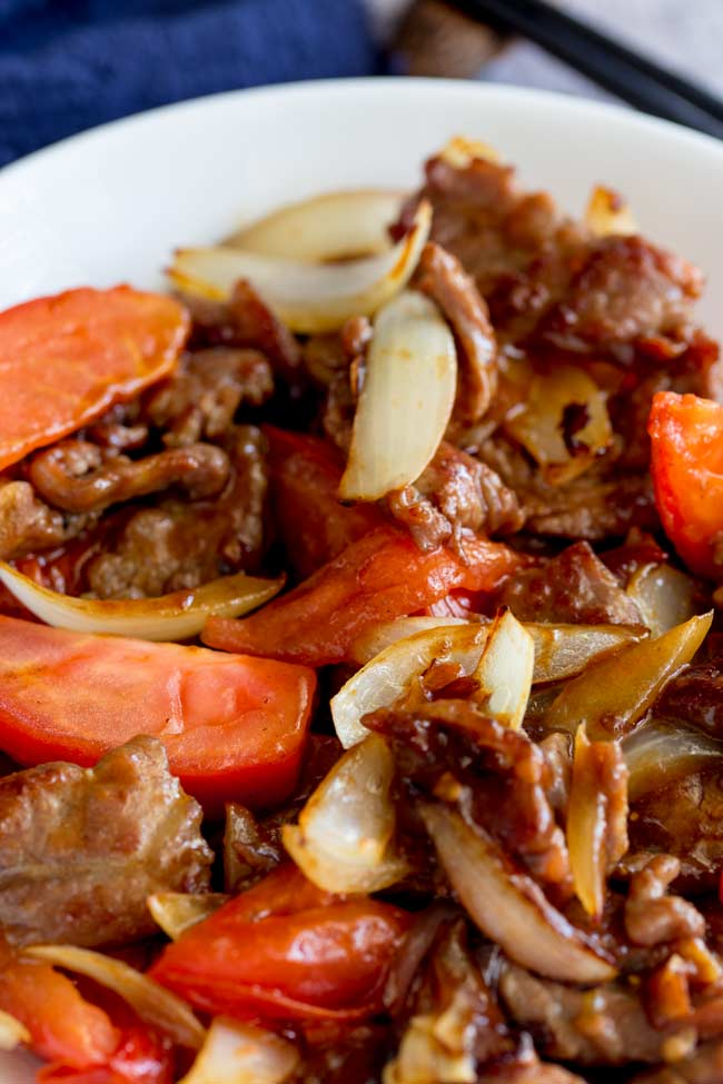 close up on the onions and beef in this chines beef stir fry