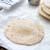 homemade flour tortilla on a sheet of baking paper