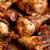 close up on a chicken portion coated in peri peri seasonings