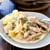 creamy pork stroganoff and noodles on a grey plate