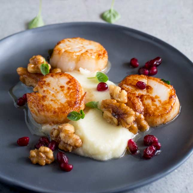 Seared Scallops With Cauliflower Puree Sprinkles And Sprouts