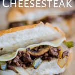 close up on the ground beef philly cheesesteak with text overplayed
