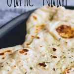 close up on a garlic naan with text at the top