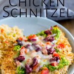 close up on the toppings of the Mexican chicken schnitzel with text at the top