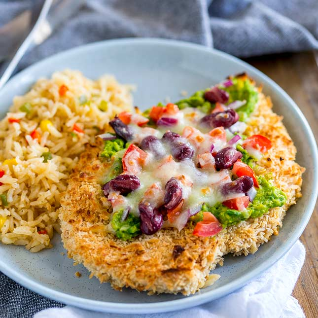 close up on the crispy schnitzel and mexican toppings