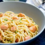 close up on the salmon pasta in a grey bowl