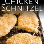 chicken schnitzel on a wire rack with text at the top