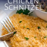 knife and fork cutting a chicken schnitzel with text at the top