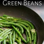pin image: close up on the right of the pan showing green beans and garlic