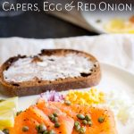 table view of a white plate with smoked salmon and egg appetizer on it