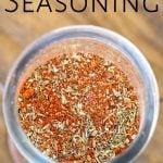 top view of a jar of creole seasoning with text at the top