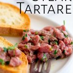 a white plate of Italian steak tartare with text at the top