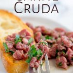 close up on the fork full of Carne Cruda with text at the top