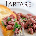 close up on the fork full of Italian steak tartare with text at the top