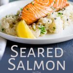 Close up on the salmon fillet sat on a bed of risotto