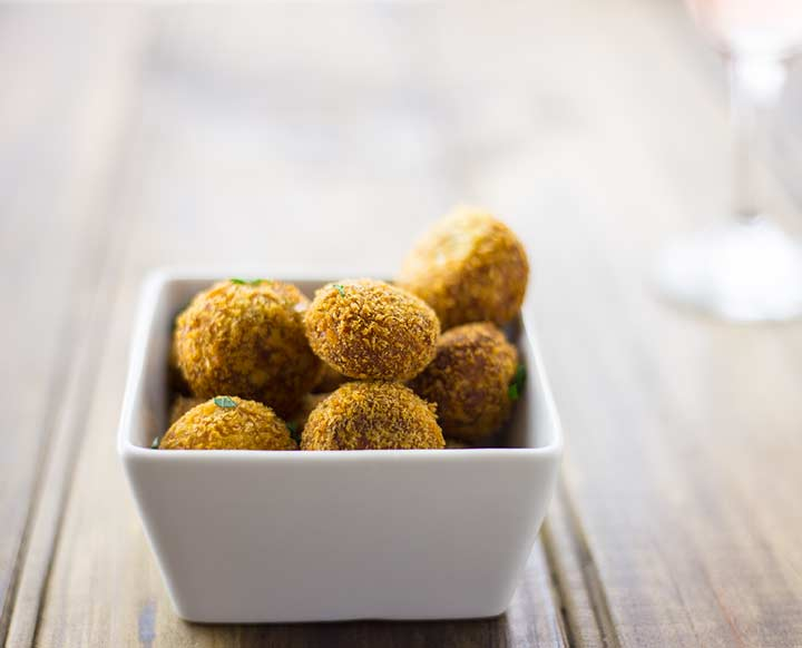 close up on the crispy color of the chicken croquettes
