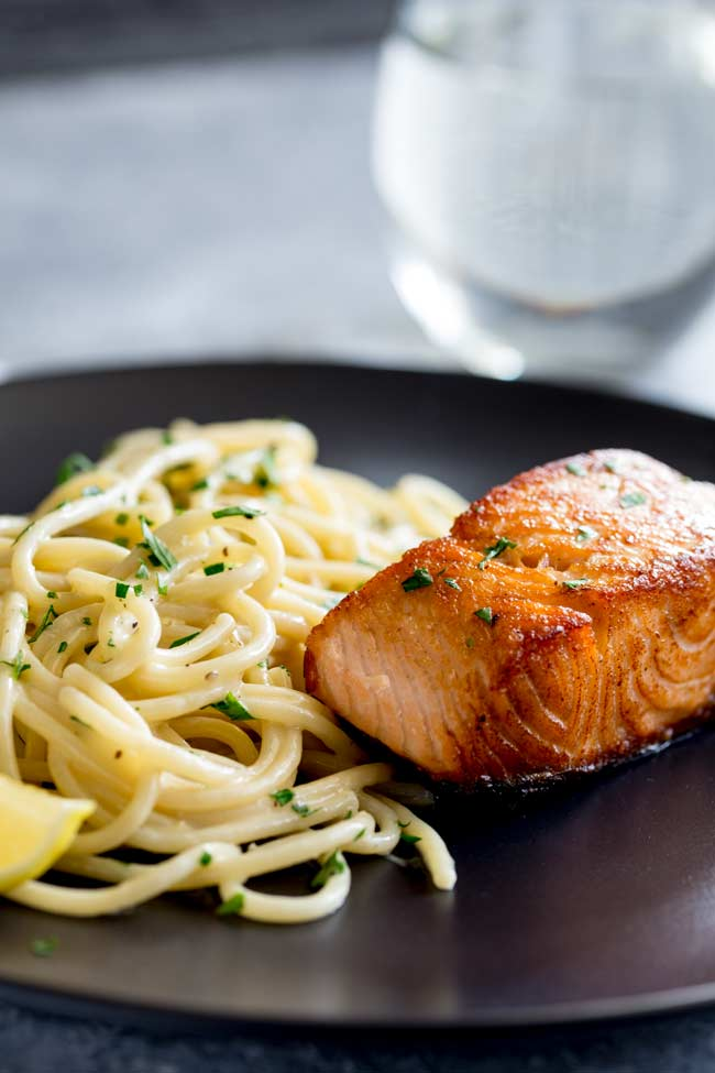 close up showing how crispy the salmon is in this salmon pasta dish