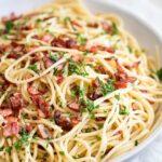 Garlic bacon spaghetti in a large shallow grey bowl