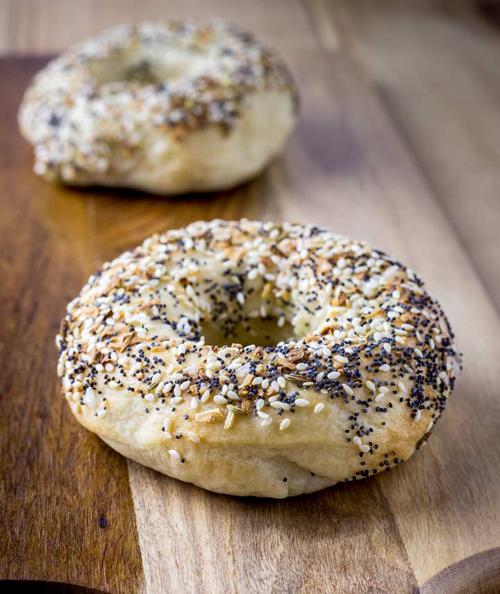 close up on the sesame seeds, poppy seeds, onion flakes and caraway seeds on a bagel