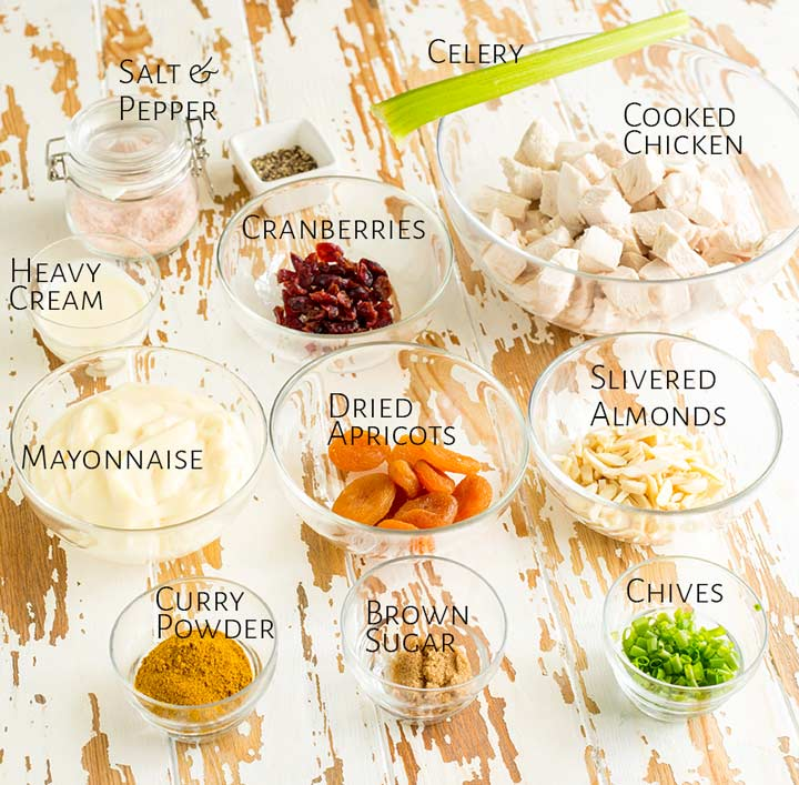 a white table with the ingredients for chicken salad