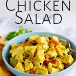 table with chicken salad in a blue bowl with text at the top