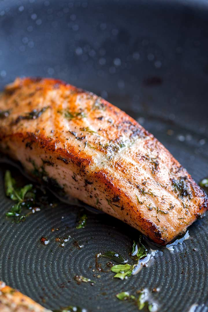 a cooked salmon fillet in a ridged frying pan