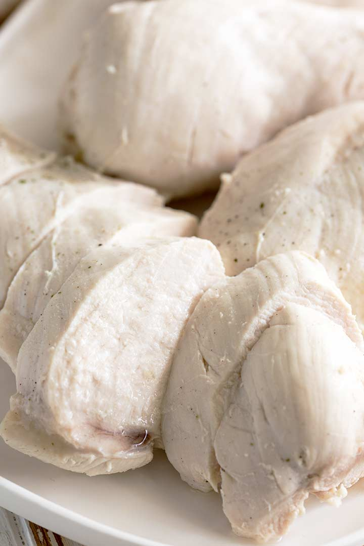 close up on a slice of poached chicken