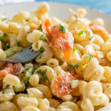 a fork lifting up smoked salmon pasta salad with spiral pasta