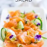 platter of smoked salmon and cucumber salad with text at the top