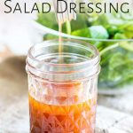 a fork stirring a salad dressing with text at the top