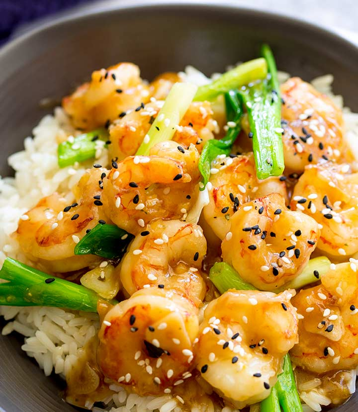 overhead shot of stir fried shrimp with sesame seeds