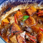 Thai Beef Massaman Curry in a white casserole dish with text at the top