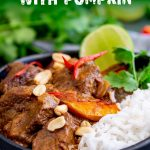 Thai Beef Massaman Curry in a black bowl with text at the top