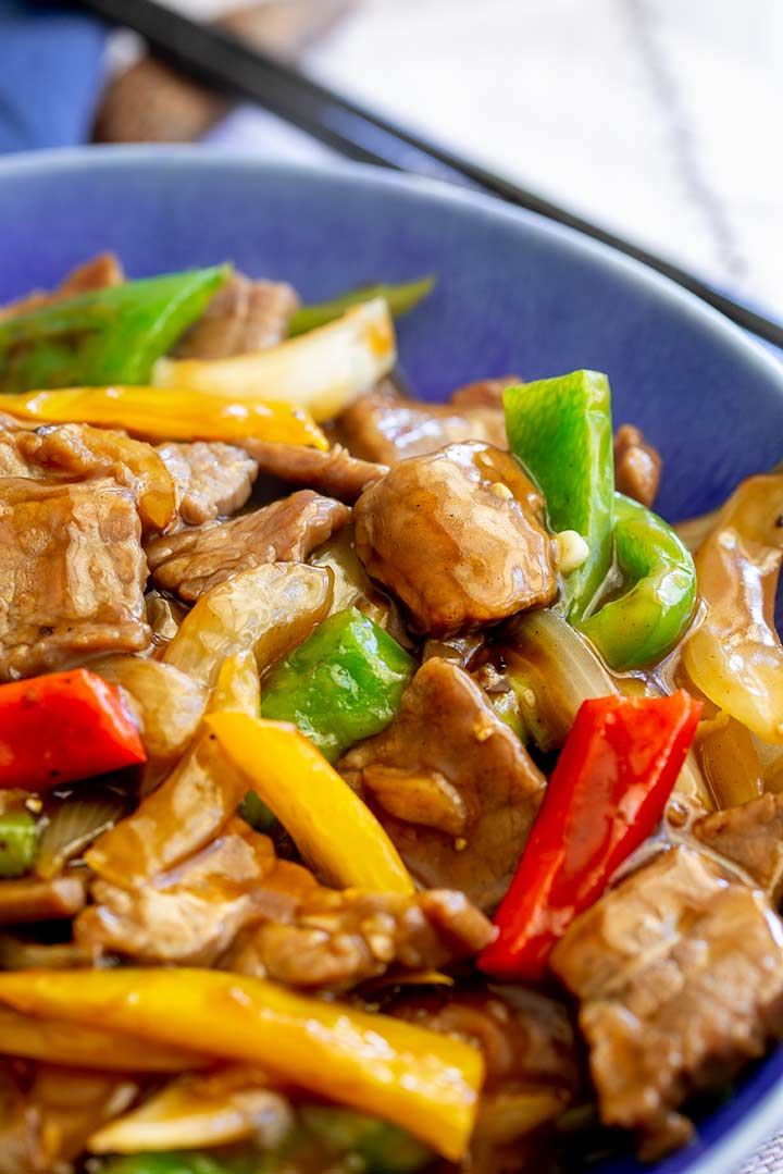 close up on a piece of beef in the stir fry