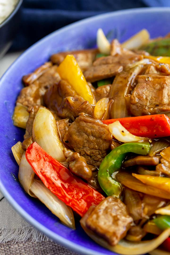 close up on the tender crisp peppers and onions in the pepper beef
