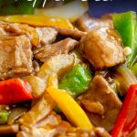 Close up of pepper beef stir fry with text at the top