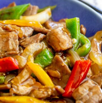 close up on strips of bell pepper with stir fried beef