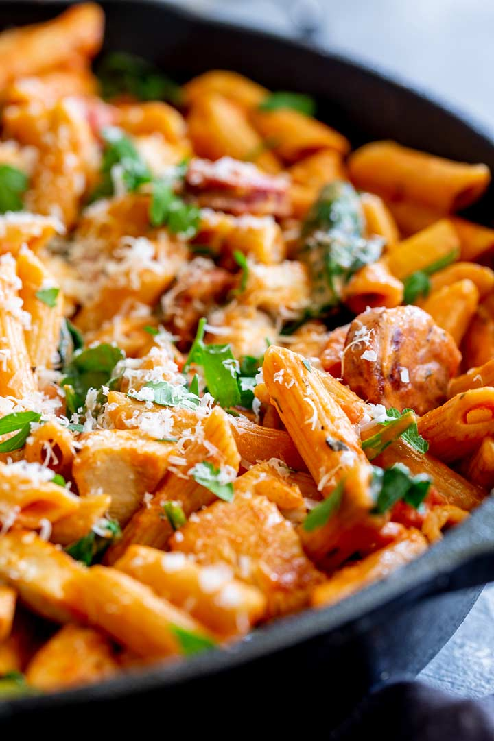 close up on a piece of penne in a creamy tomato sauce